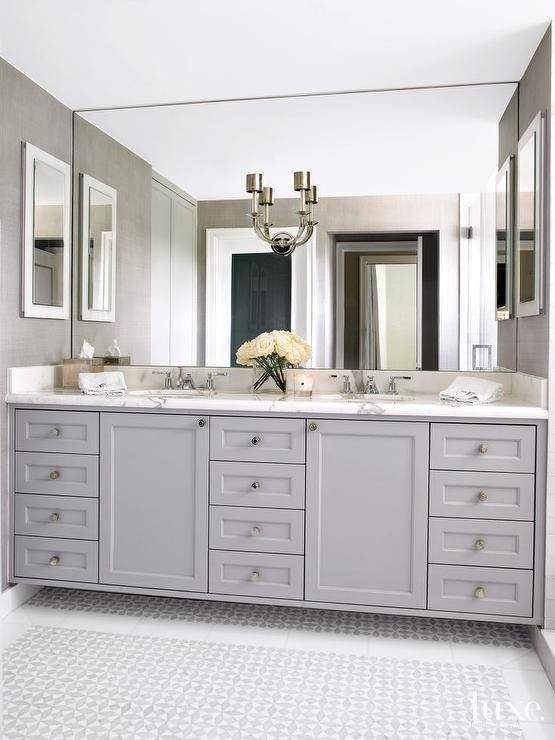Elegant Bathroom Features A Gray Dual Sink Vanity Topped With Statuary  Marble Fitted With His And