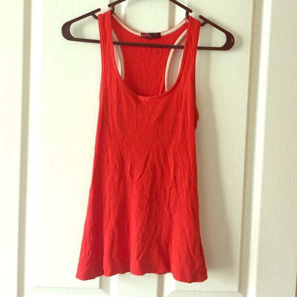 Christmas SALE Orange Ribbed Tank Basic tank, great for layering. Willing to bundle with other basic tanks 5 for $10 - ask for bundle. If bundling with other items, please use bundle feature | NO TRADES NO PAYPAL please ❤️ Price firm unless bundled. Forever 21 Tops Tank Tops