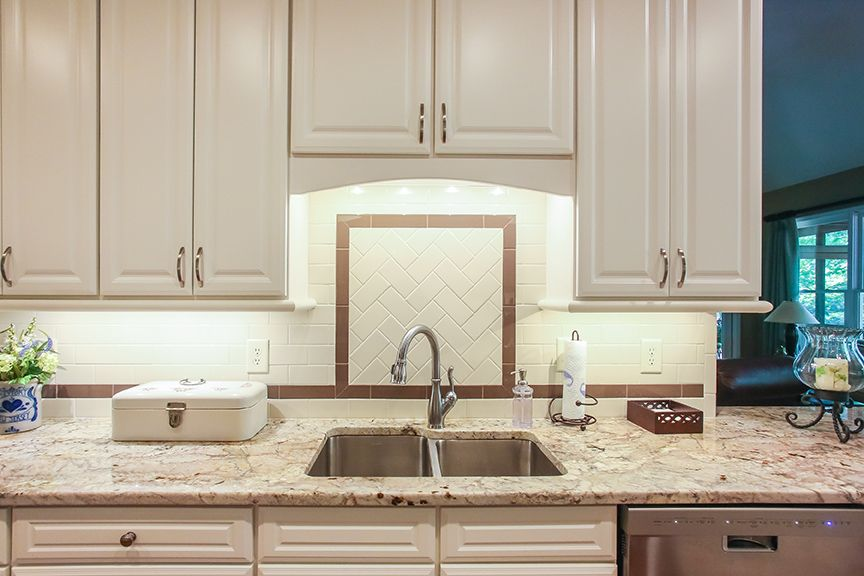 Accent tile creates a great feature above the kitchen sink ...