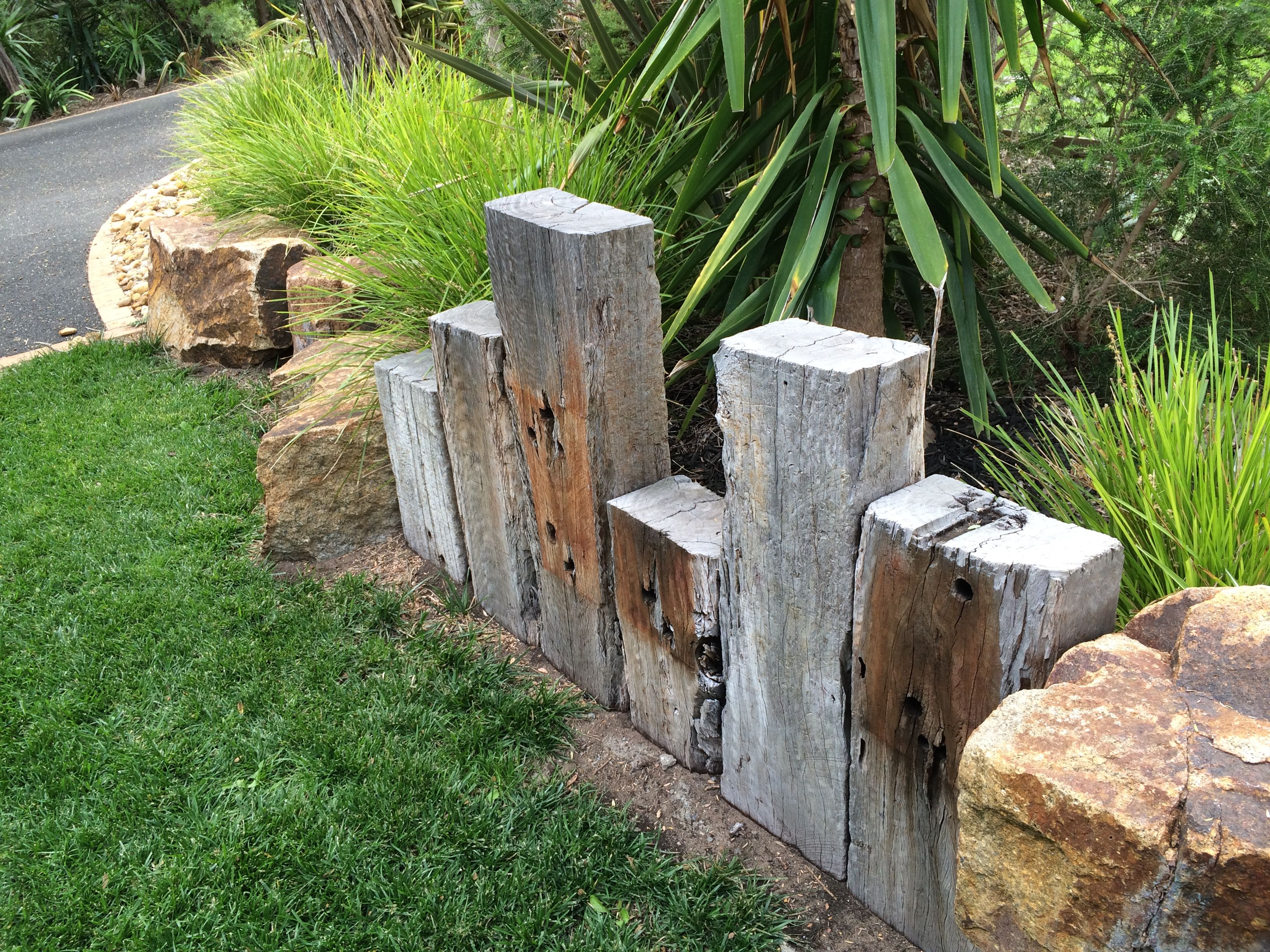 Vertical sleepers as retaining wall or edging for Landscaping rocks wellington