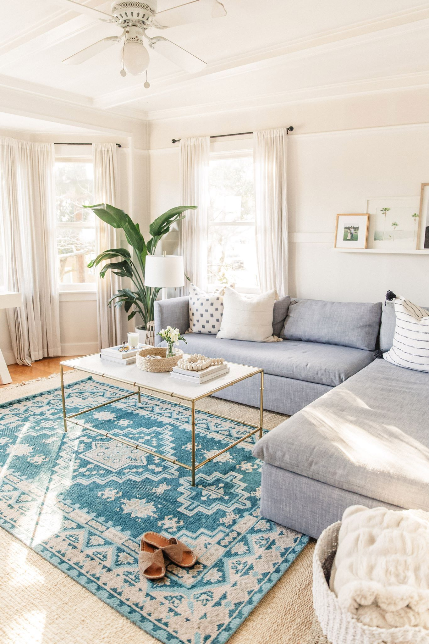 The color pop from the rug really makes this space a lot more interesting and grounds
