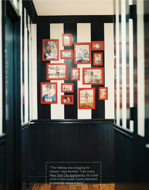 These vibrant red frames POP on this black and white striped wall!
