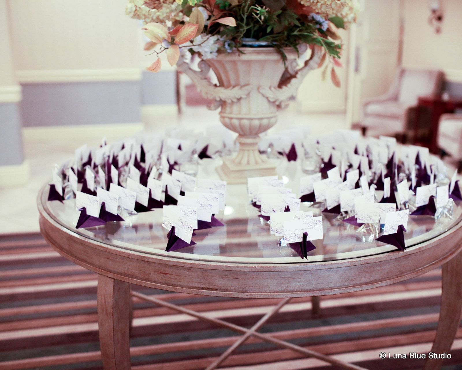 A table full of origami crane escort cards we love this creative a table full of origami crane escort cards we love this creative idea www jeuxipadfo Choice Image