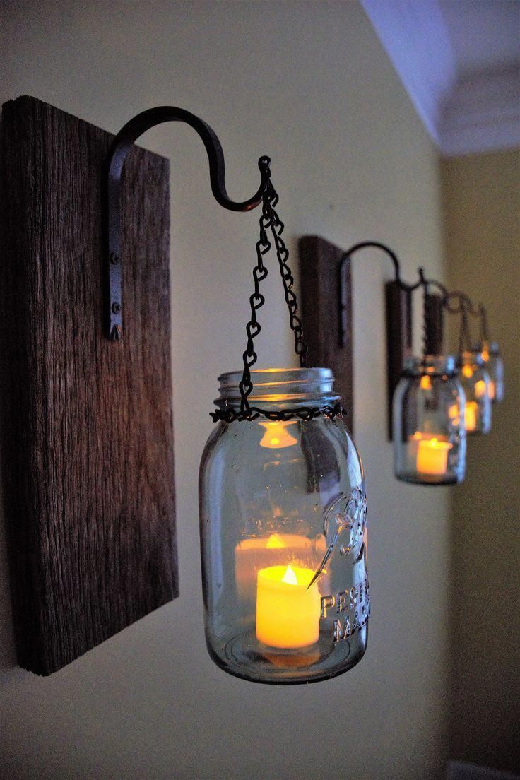 Mason Jar Candle Sconces made from Reclaimed barn wood. #WoodworkingOutdoorMasonJars