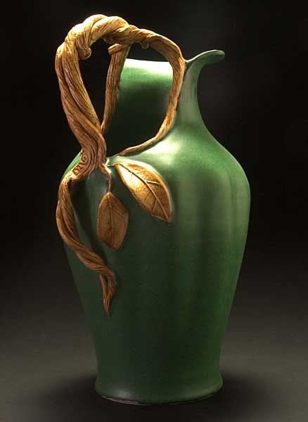Stoneware Ewer with a woodland inspired design including a vine double twisted vine handle and rich green matte glaze in the style of an acorn squash