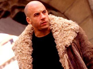 Vin Disel in XXX wearing a beaver fur with wool collar coat by Gucci
