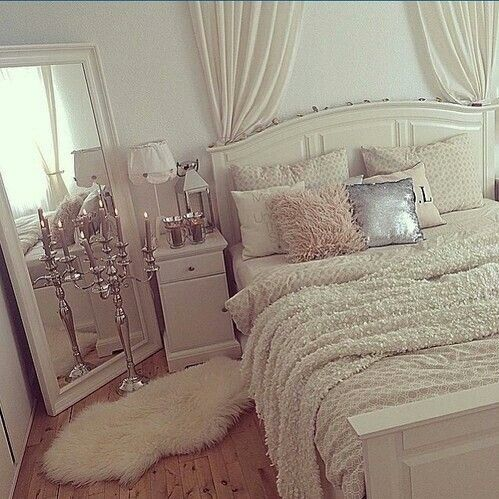 Mirror propped diagonally in the corner. Curtains for a ...