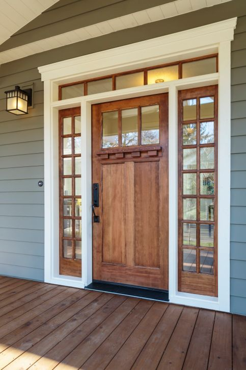The Thin Strip Of Glass In The Door Provides Visual Interest And The Strong Monochromatic Look Of The Black A House Exterior Front Door Design Craftsman House