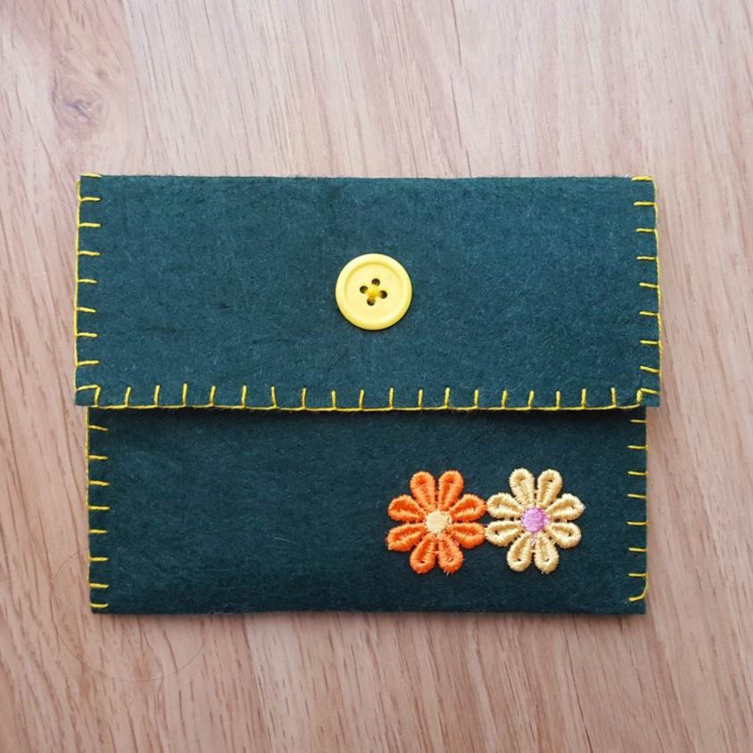 Felt purse with button, dark green with orange and yellow flowers ...