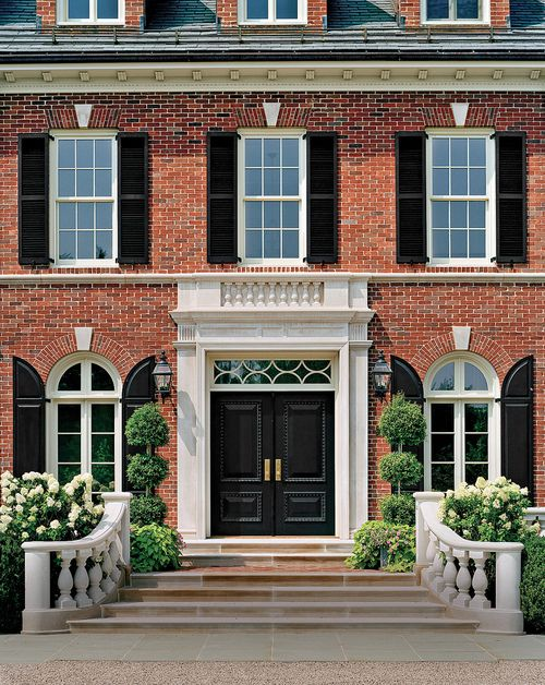 Red Brick With Black Shutters I Like The Rounded Black Shutters For The Curved Windows And The White Stone K Exterior Brick Brick Exterior House House Exterior