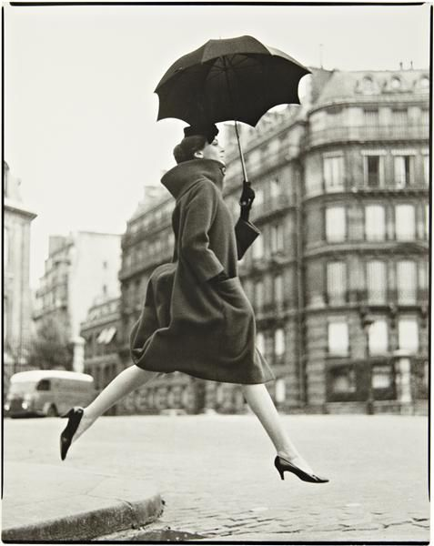 I've always loved this effortless shot.  RICHARD AVEDON  'Homage to Munkacsi.' Carmen, model. Coat by Cardin. Place François 1er, Paris, August,1957