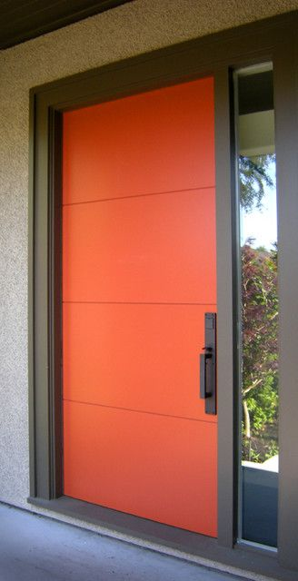 Orange Valdi Door in aluminium and laminated glass.