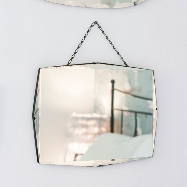 mirror on chain. aged chained mirror from the other duckling. this vintage with its pretty hanging chain on j