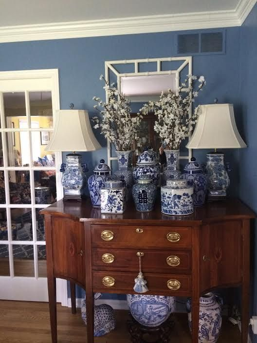 Pair Of Chinoiserie Lamps And Ginger Jars On Top Underneath The Dining Room Sideboard