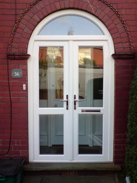 Double upvc front doors for arched porch google search for Double glazed porch doors
