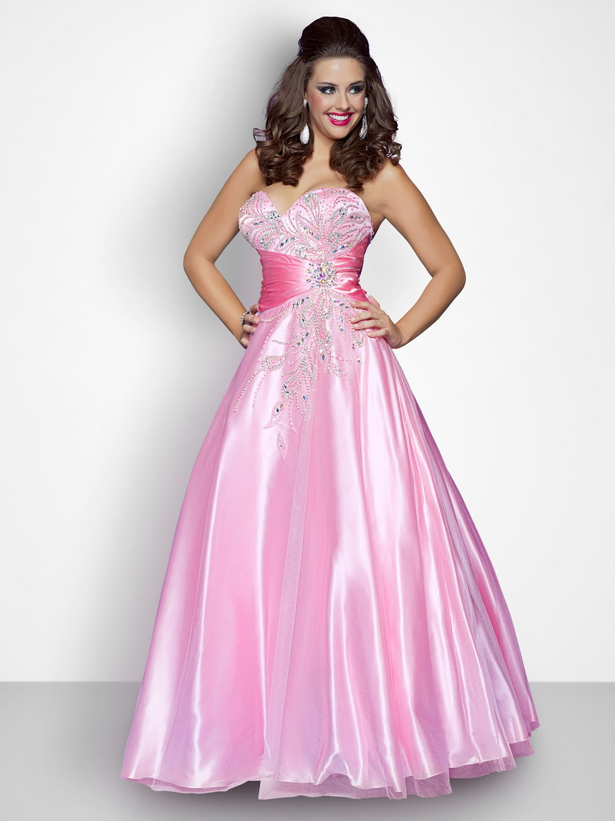 Dazzle on the dance floor sporting the blush prom dress w this
