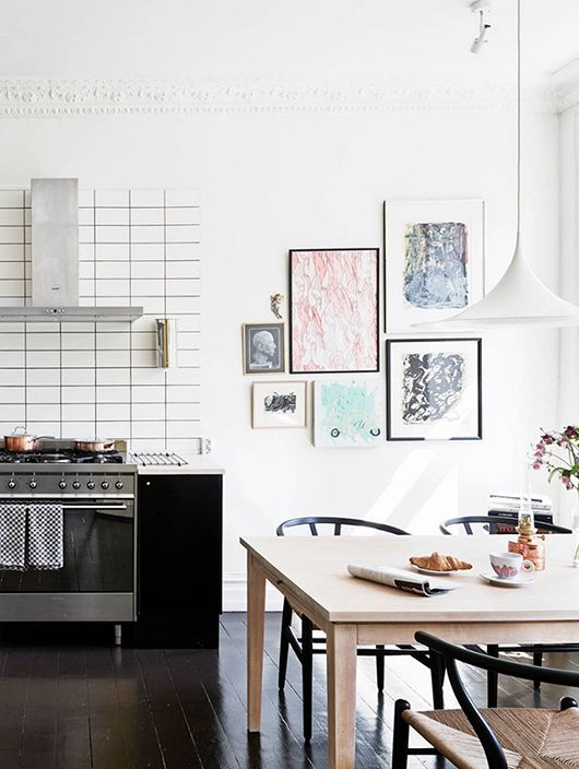 Stacked Subway Tile With Dark Grout + Black Wishbone Chairs + White Modern  Pendant