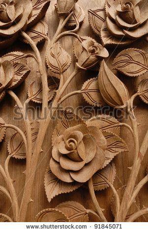 Rose flower thai style teak wood carving door in chiangmai