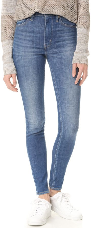 804b0d09d6bce1 A faded wash complements the formfitting cut of these high-rise Levi s  cropped skinny jeans. 5-pocket styling. Button closure and zip fly.