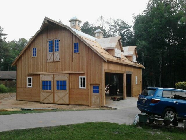 Wood barn kits rv garages barn plans barn doors and for Barns with apartments above