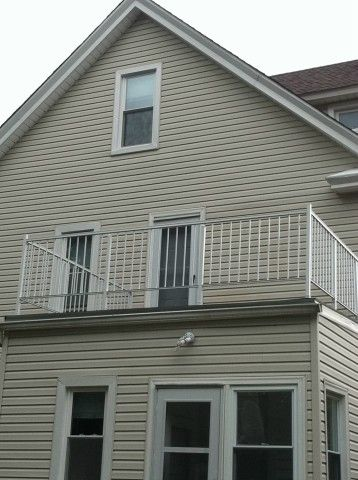 Upper floor porch railing installed by Fairview Home Improvement in ...