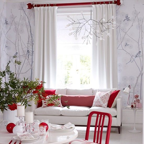 Red and white Scandi style living room with decorative red