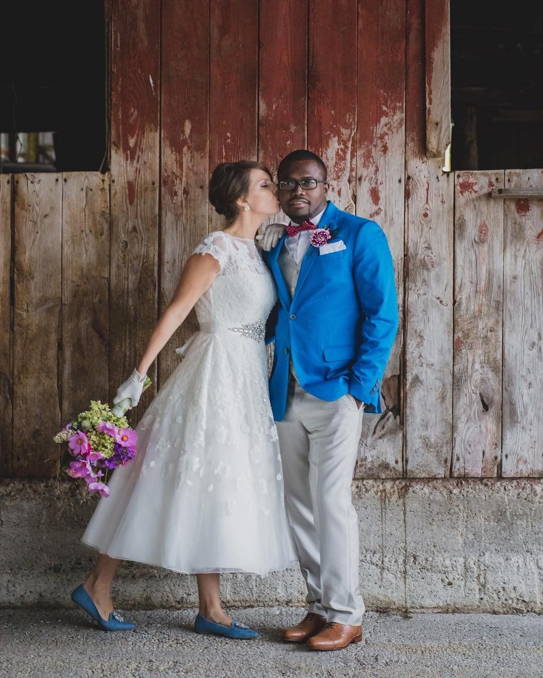 Davidus bridal bride in a lace cap sleeve short wedding dress by