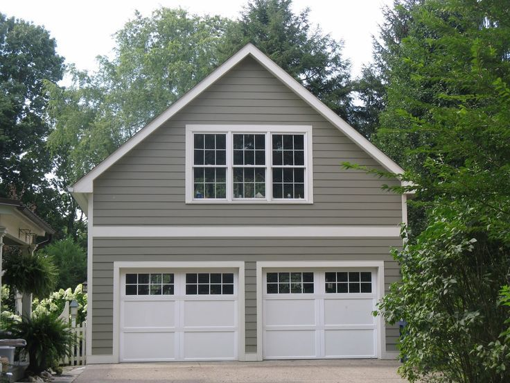 Garage doors should always recede thus should be a darker for Garage designs with living space above