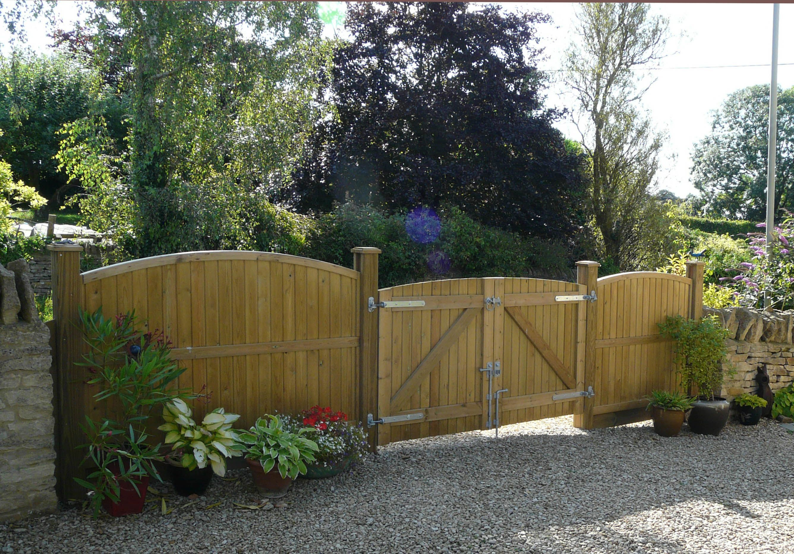 Our arched top convex wooden featherboard garden gates are
