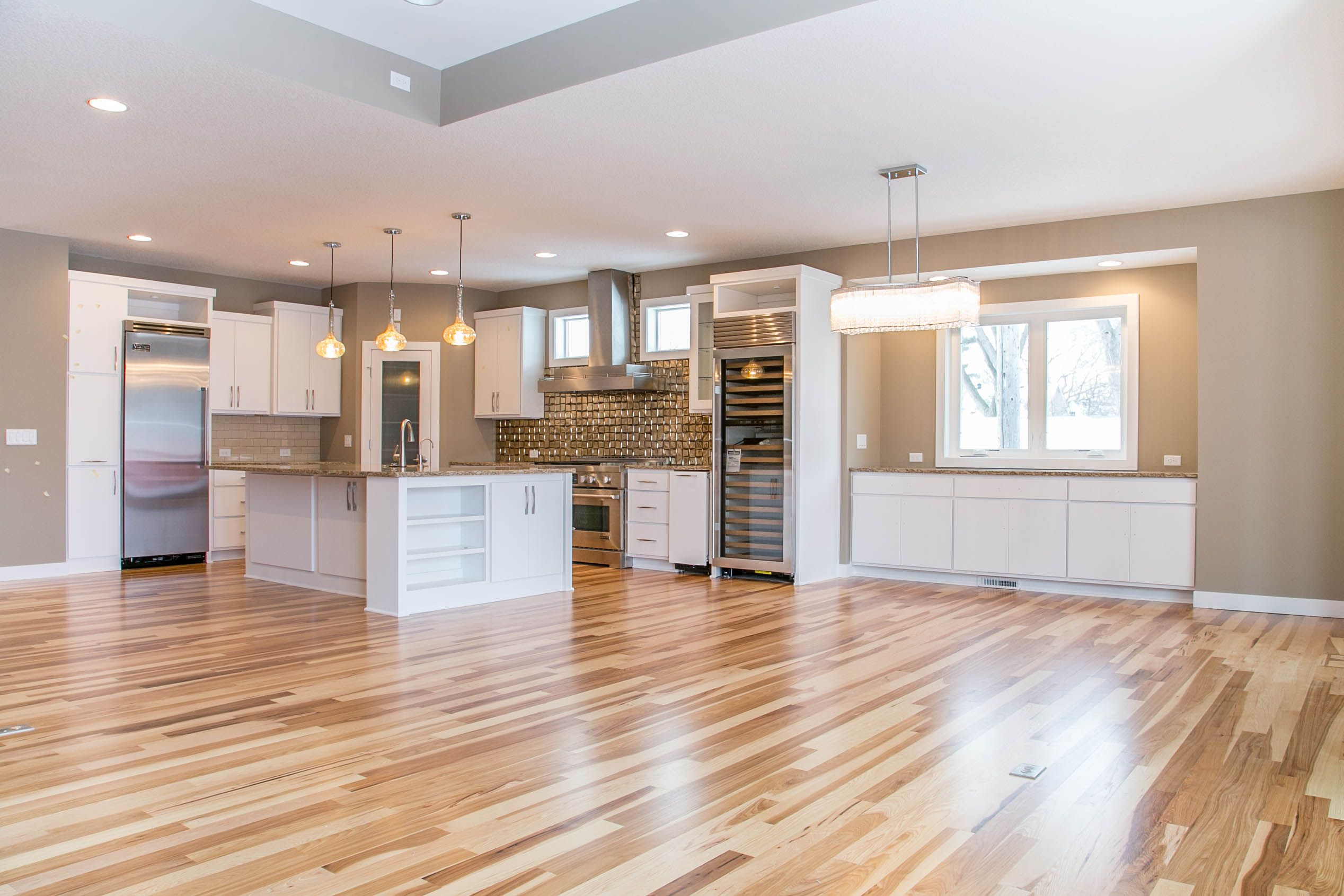This Ldk Custom Kitchen And Dining Has The Perfect Open And Spacious Floor Plan The Maxim And Uttermost Lighting Is Stunning And S Custom Kitchen Home Kitchen