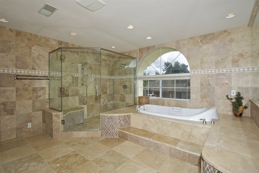 high ceiling master bath with frameless shower in center - Google Search