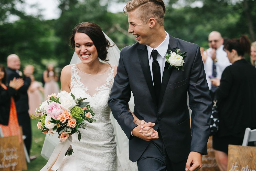 I love this image of the bride and groom walking down the isle!