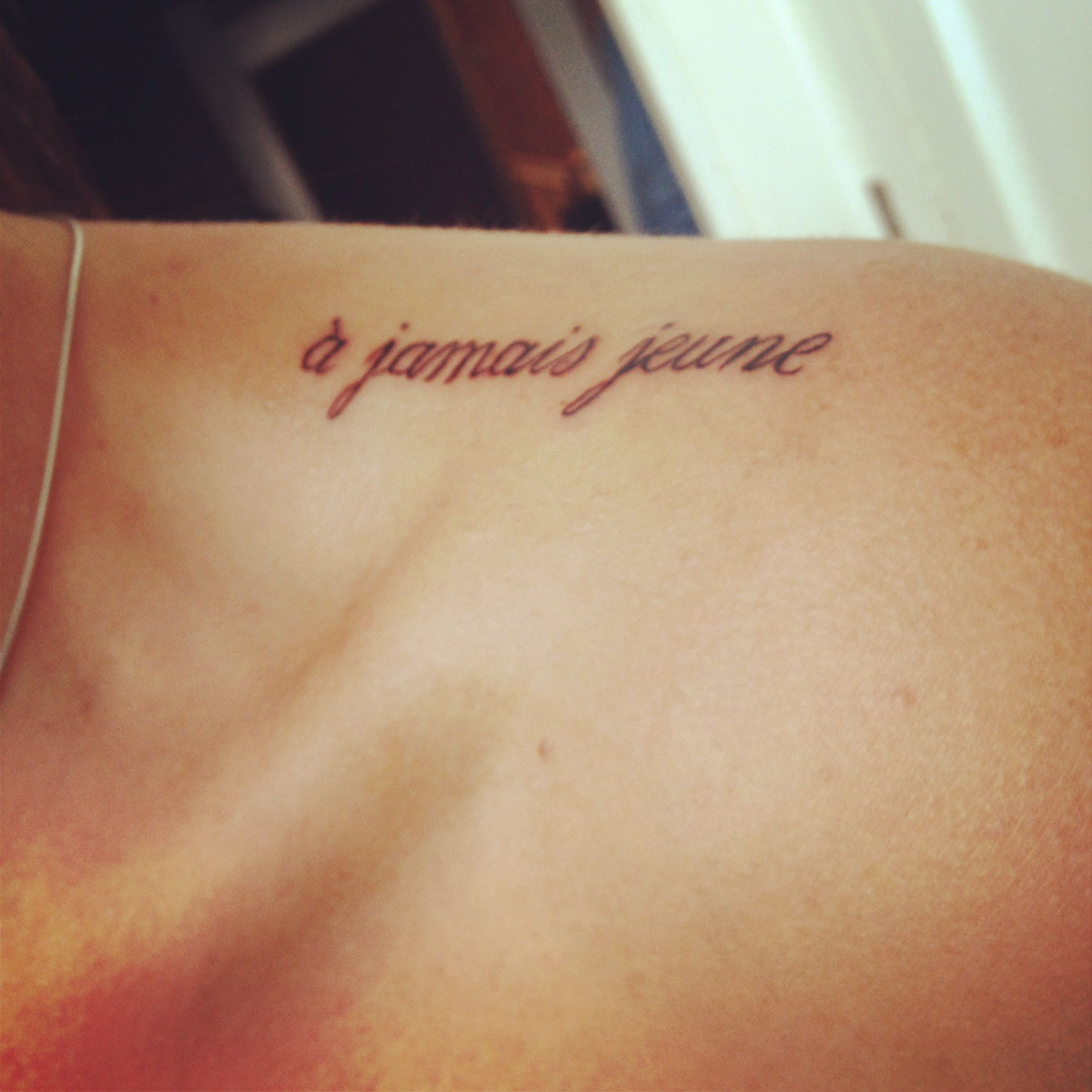 "French Tattoo Ideas: ""Forever Young"" French Script."