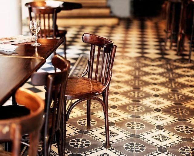 Moroccan-inspired tiled floor, Hotel Du Nord Cafe