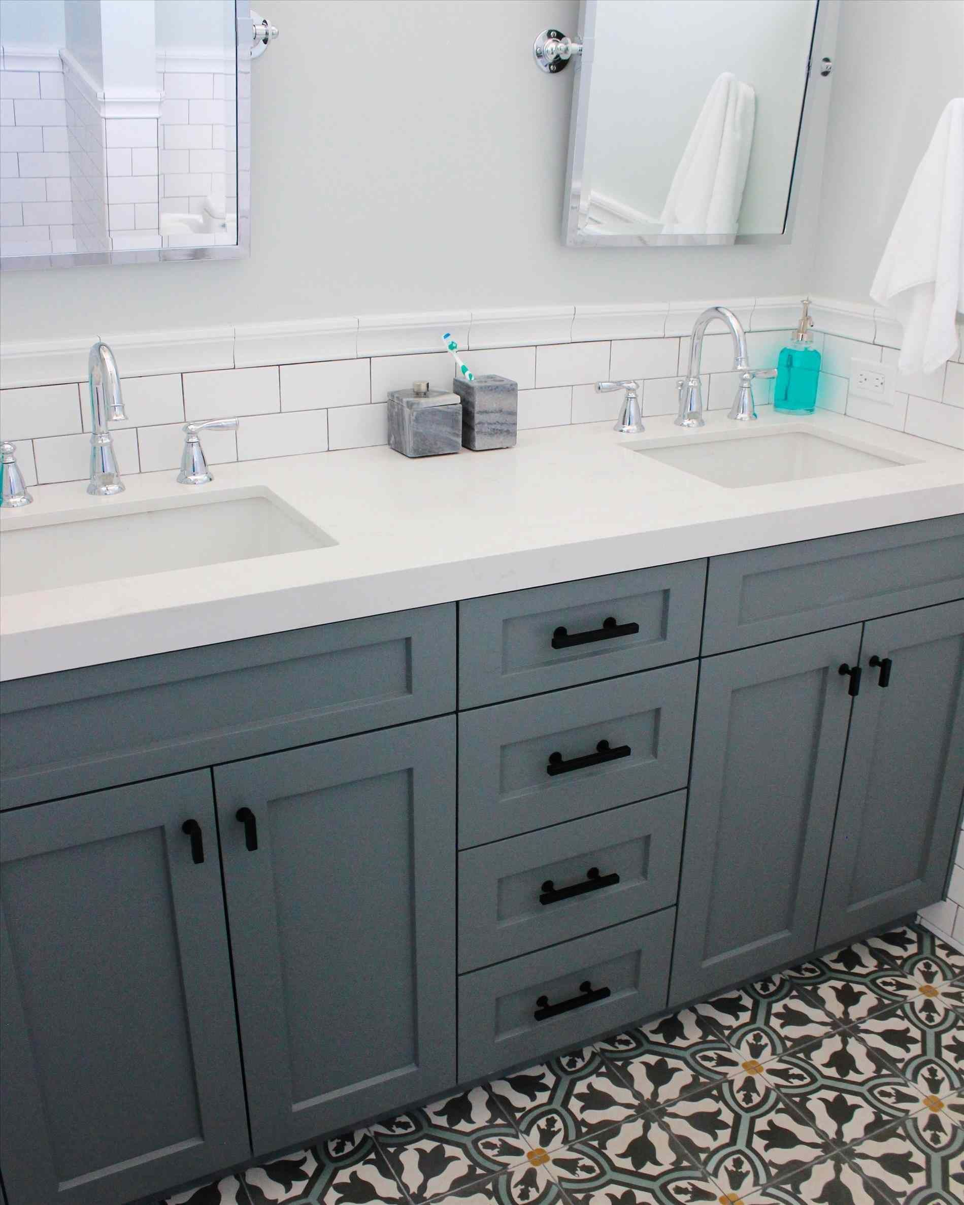 White subway tile, white counter, and gray/blue vanity with neutral ...