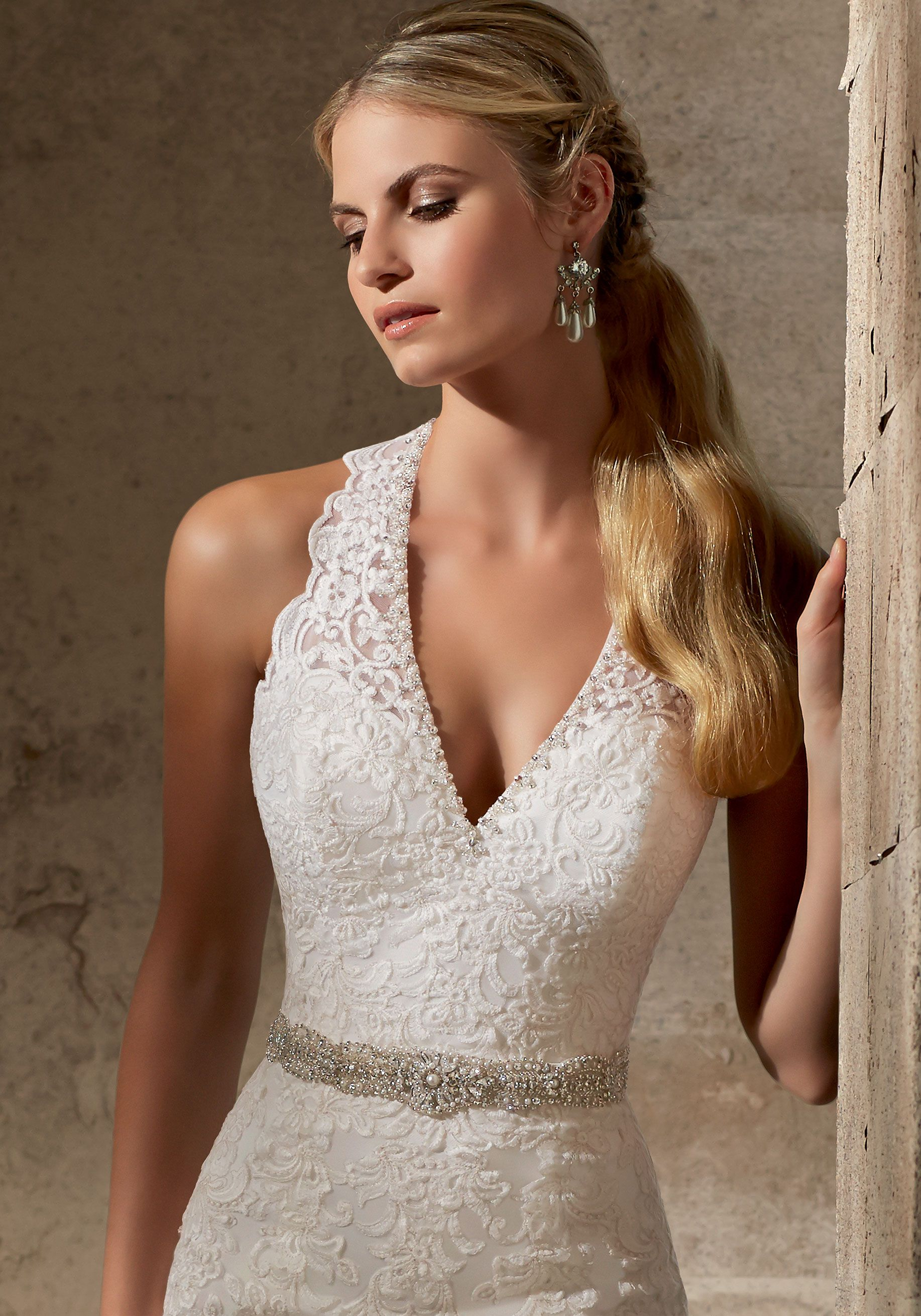 The halter wedding dress scalloped illusion neckline and a double