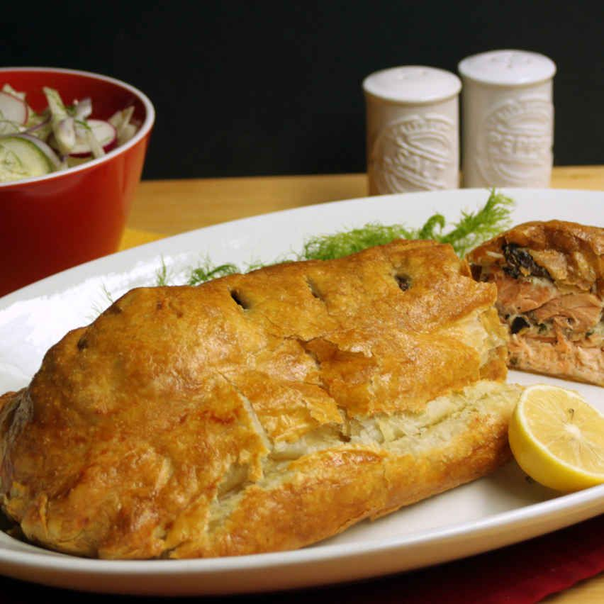 Garlic-Herb Salmon en Croute with Fennel and Cucumber Salad.