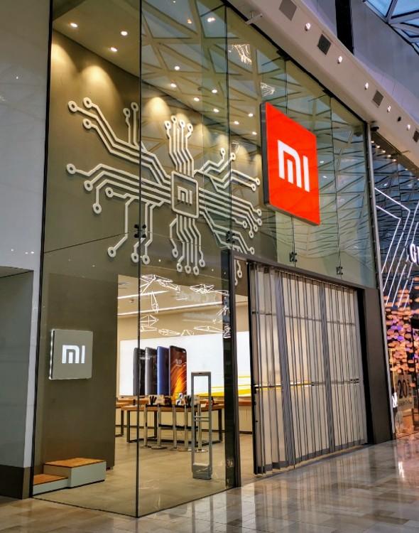 Exclusive Insight To The Design Of The Circuit Board Logo At Mi Store London Xiaomi Mi Communit Shop Board Design Mobile Shop Design Retail Space Design
