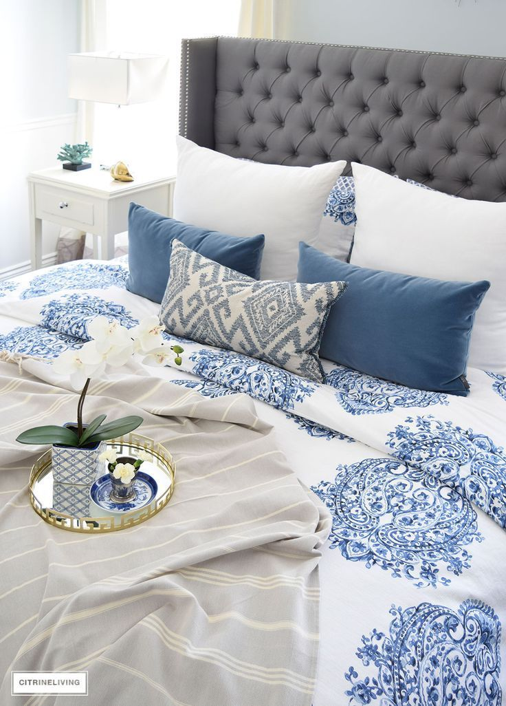 Gorgeous blue and white bedroom featuring blue