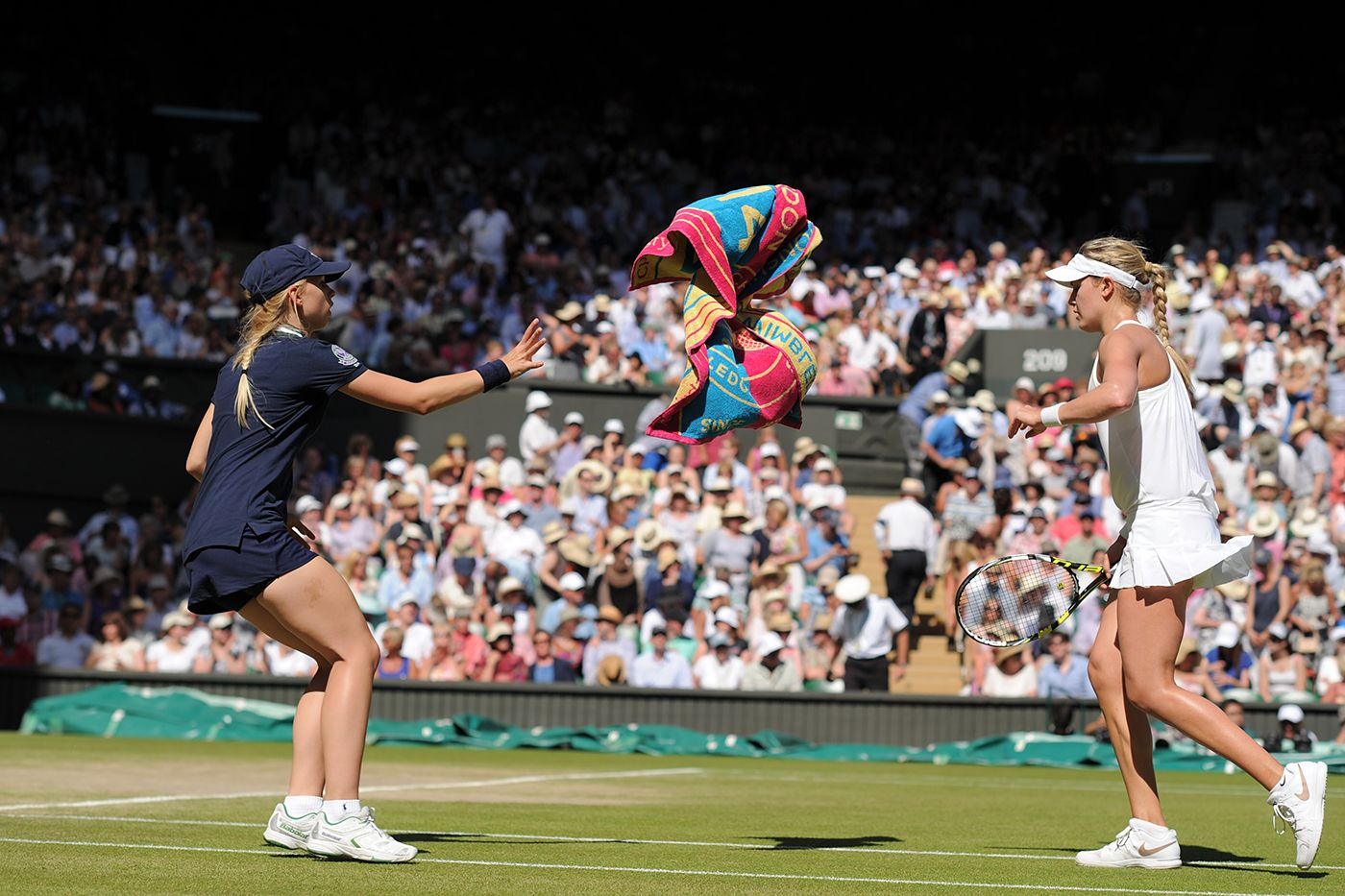 Eugenie Bouchard throws a towel to a Ball girl on Centre