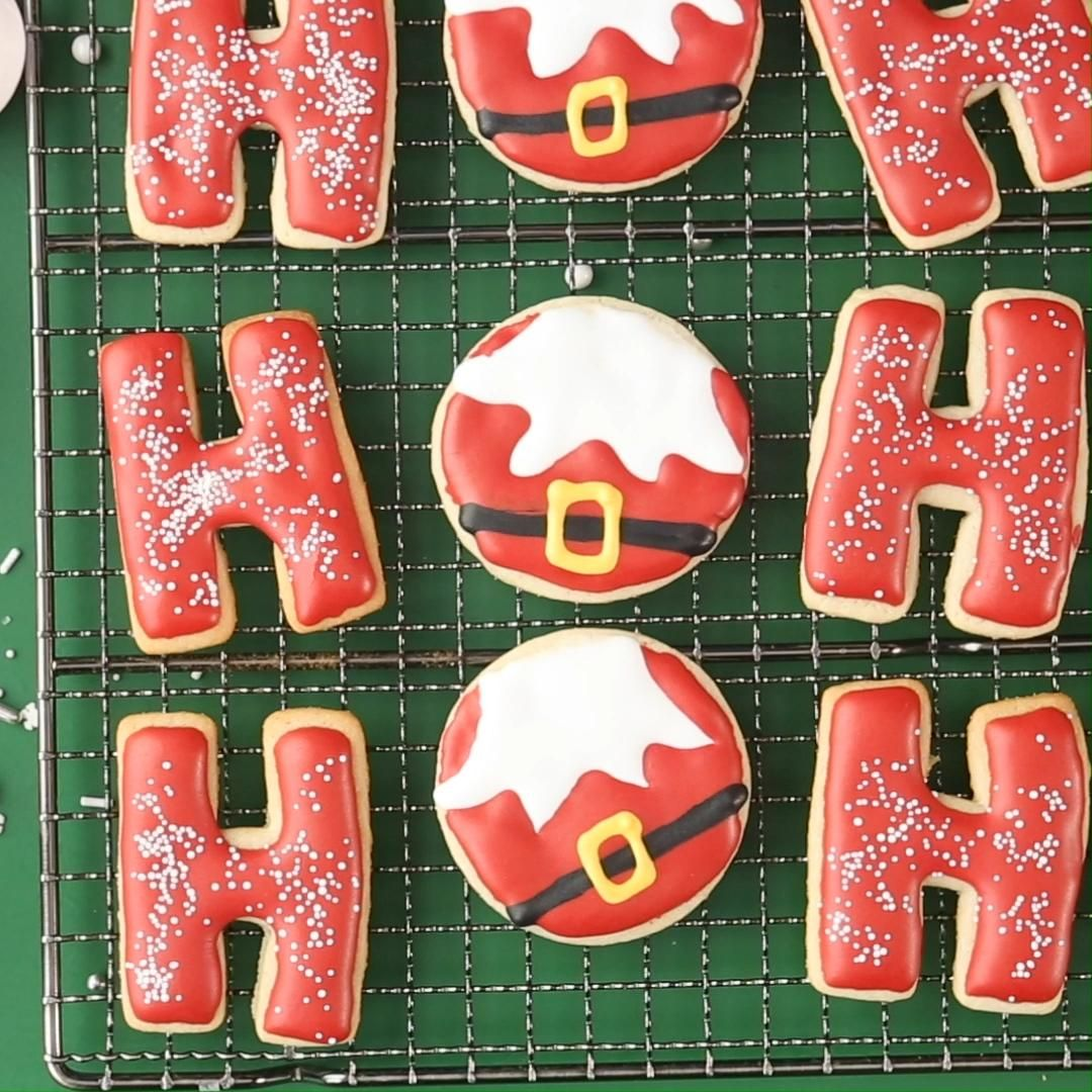 Instead of classic (but still adorable) Santa belly cookies for Christmas, we've taken it up a notch by pairing decorated round sugar cookies with cookies cut as the letter H for a special and unique Ho Ho Ho cutout sugar cookie display. #christmascookies #cutoutsugarcookies #decoratedsugarcookies #decoratedsantacookies #bhg