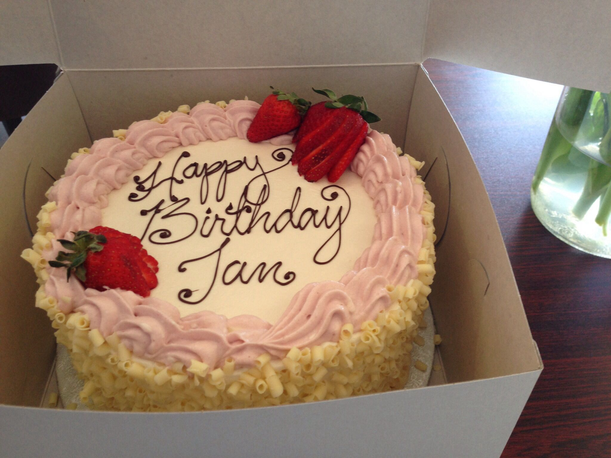 Pretty white chocolate curls and fresh strawberries adorn this simple birthday cake. Nut-free bakery White Rock BC