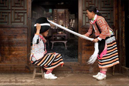 hmong longhorn women wear horns