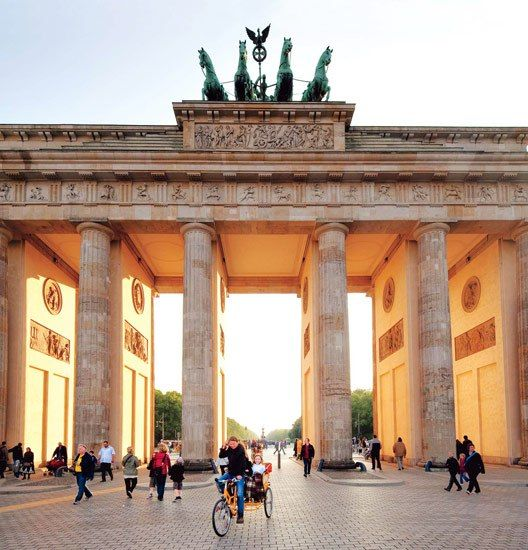 Built As A City Entrance Leading To The Palace Of The Prussian Monarchs The Brandenburg Gate Became A Symbol Of Freedom A Berlin Germany Germany Travel Berlin