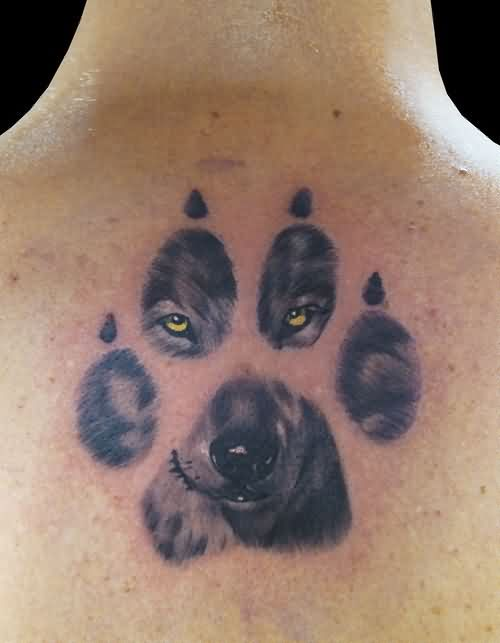 Great Realistic Wolf Face In Paw Print Tattoo I Would Do My Dog Though Wolf Tattoos Wolf Print Tattoo White Wolf Tattoo