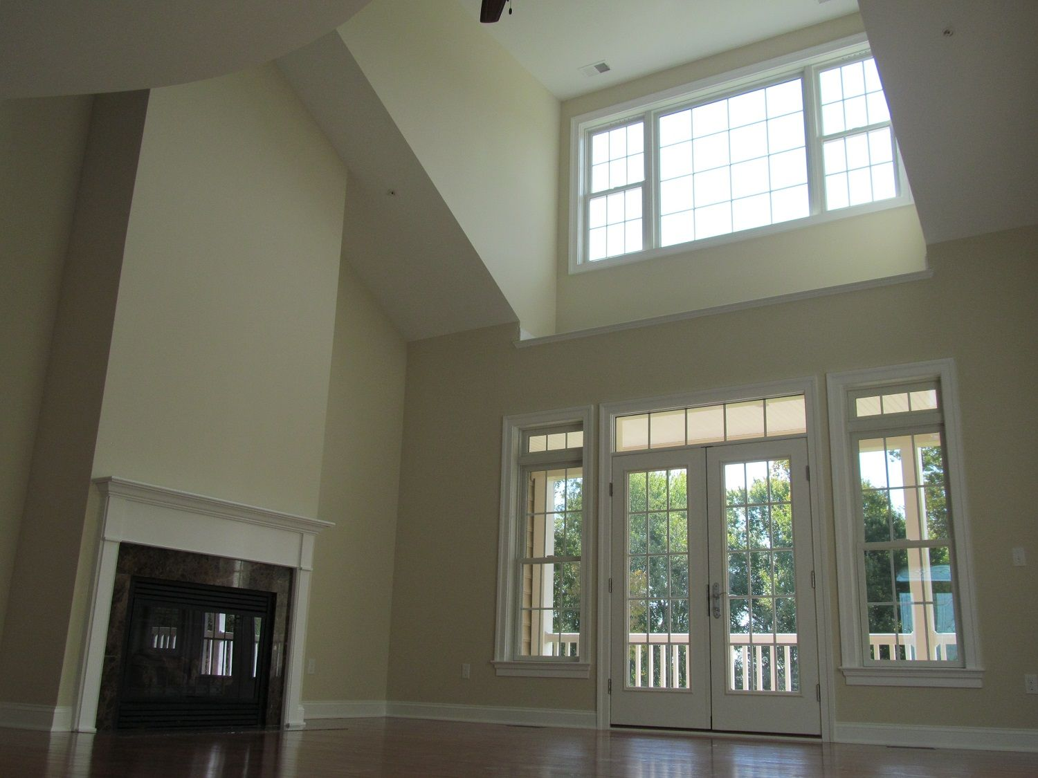 living room two story with dormer sloped ceilings room