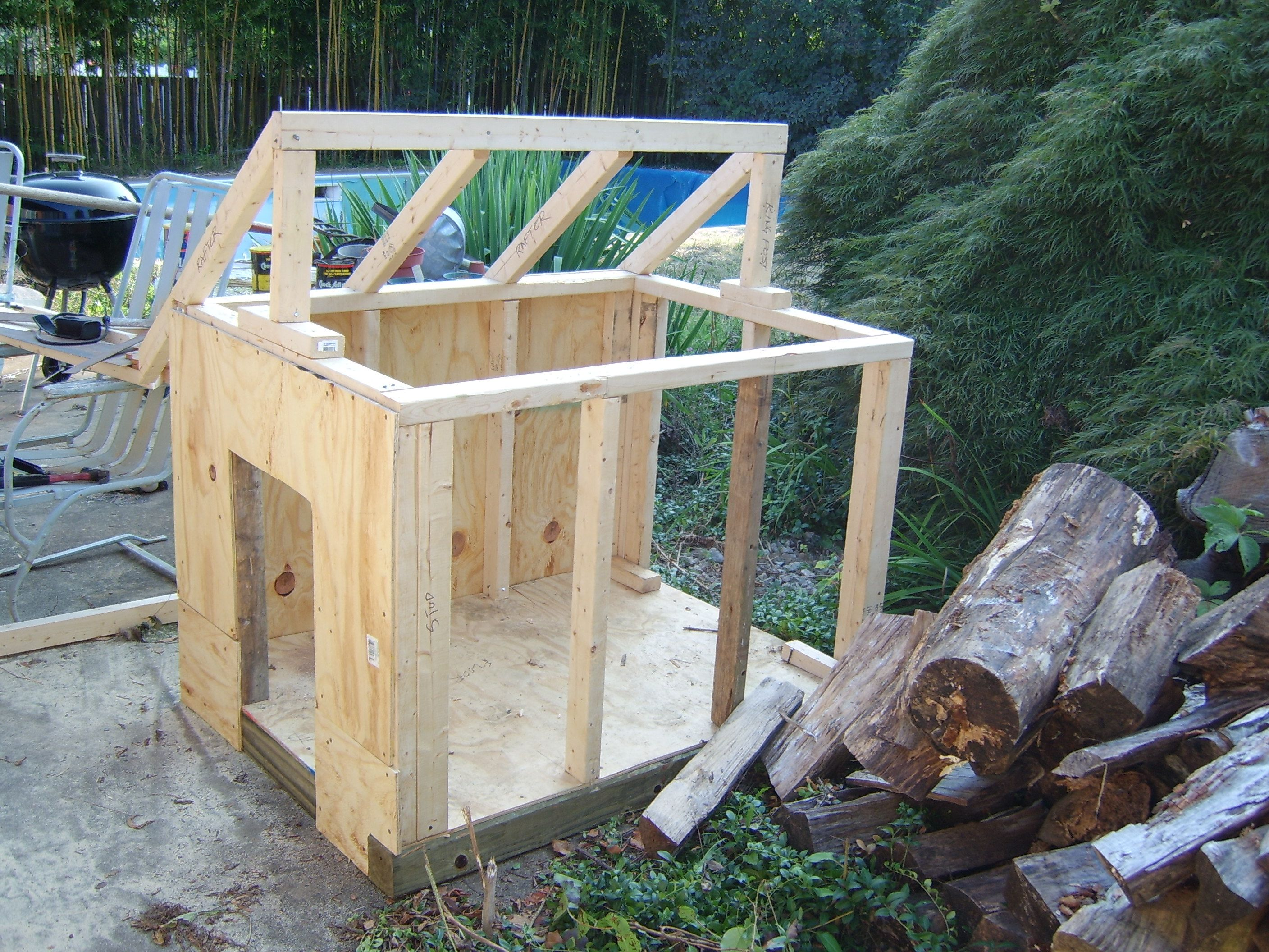 Learn how to make a slanted roof on a DIY dog house dogs