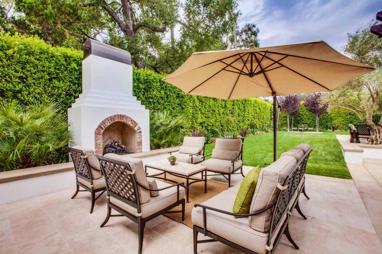 this spanish style outdoor fireplace provides the perfect place to rh pinterest com  spanish style patio chairs