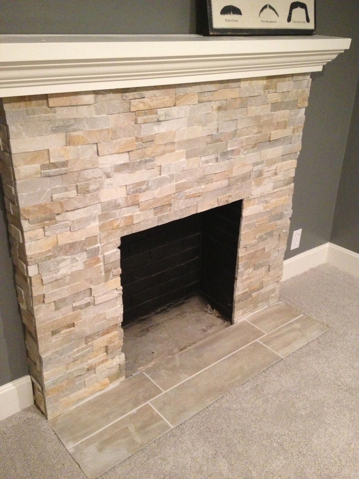 i like the stone for the whole wall of the fireplace with a modern