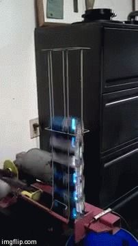My friend's automatic beer can crusher
